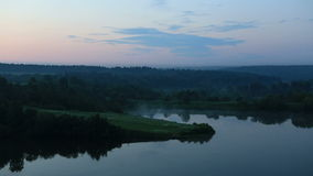 Fog over the Ptitsegradsky pond in the early hours. Stock Photography