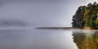 Fog over quiet lake, early morning royalty free stock photography