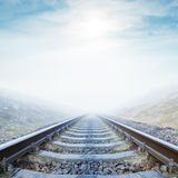 Fog over railroad and clouds with sun Royalty Free Stock Image