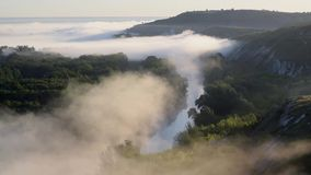 Fog over river and hills. Fog quickly moves over river and hills, morning landscape. Accelerated footage stock video