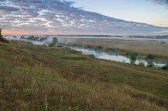 Fog over the river Stock Photos