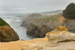Fog over rugged terrane of  Mendocino Headlands State Park. Stock Image