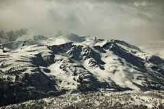 Fog over snowy mountains Royalty Free Stock Photography