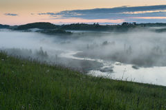 Fog. Over the swampy river before sunrise Stock Photography