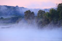 Fog over Truman Lake. With pastel colors in the sky.  Truman lake is in the Lake of the Ozarks area of Missouri Stock Photography