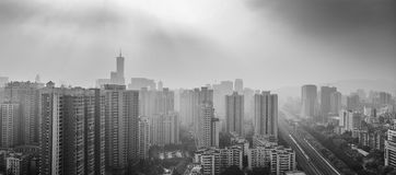 Fog over urban skyline Stock Photos