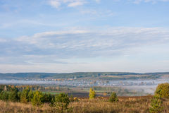 Fog over the village early in the morning Royalty Free Stock Photography