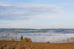 Fog over the village early in the morning Stock Image