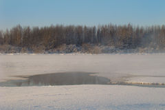 Fog over the water. Fog over the clearing of warm water in winter Stock Photos