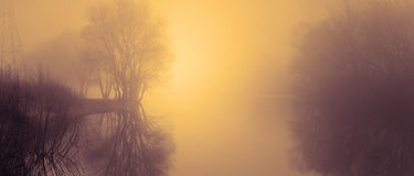 Fog over water in the spring in the early morning. Royalty Free Stock Photography