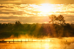 Fog over the water during sunrise Royalty Free Stock Images