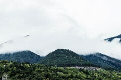 Fog over wooded hillside, Andorra Royalty Free Stock Photo