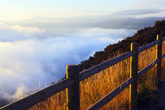 Fog over wooded mountains. In summer morning.  Galicia Royalty Free Stock Photos