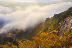 Fog over wooded mountains. In summer sunset.   Spain Stock Image