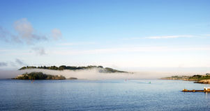 Fog in Plymouth Sound. England between Drakes Island and Mount Edgcumbe Stock Photography