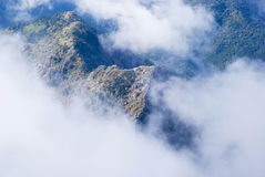 Fog revealing the mountain range Stock Photo