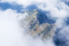 Fog revealing the mountain range Stock Photography