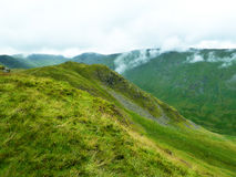 Fog rising around the hills in Lake District. Beautiful English landscape with fog rising around the hills in Lake District Royalty Free Stock Image