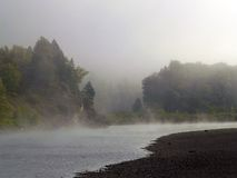 Fog Rising from the River. This image of the fog, river and fall foilage was taken in western MT Stock Image