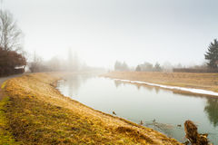 Fog on the river in autumn Royalty Free Stock Photos
