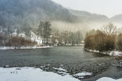 Fog on the river in winter countryside. Gloomy overcast weather Royalty Free Stock Image