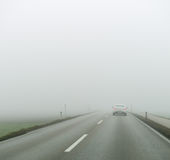 Fog on a road with cars Stock Photography