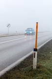 Fog on a road with cars stock image
