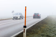 Fog on a road with cars Stock Photo