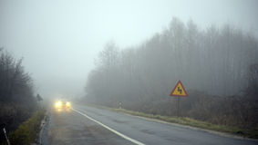Fog on the road Stock Images
