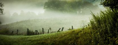 Fog rolling through blue ridge parkway farm lands Stock Photography
