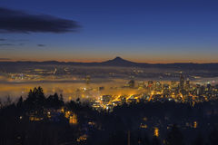 Fog Rolling in at Dawn over the cityscape of Portland Stock Photos