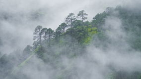 Fog rolls across flowing over Mountains stock video footage