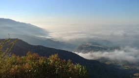 Waves of Fog. The fog rolls onto the slopes of the San Gabriel Mountain foothills royalty free stock images