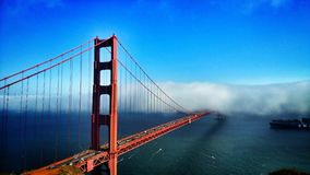 When the fog rolls in. Fog over the golden gate bridge Stock Images