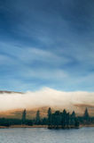 Fog Rolls over Mountains Stock Images