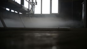 Fog in the room of a concrete plant stock video