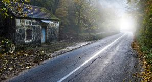 Fog at ruin house and road. View of a fog at old aged stone Dalmatian ruin house and road. Horizontal color photo Stock Image