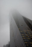 Fog Scraper. Fog covering the top of a sky scraper Royalty Free Stock Image