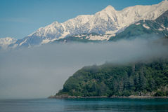 Fog, Sea And Mountains Near Whittier, Alaska Stock Photo