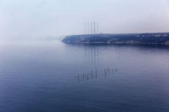 Fog. Seascape with fishing nets with the effect of film grain. Royalty Free Stock Photos