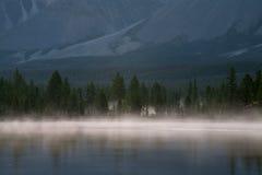 Fog on the shore of a mountain lake. Lake Darpir. Yakutia. Russia Royalty Free Stock Photos