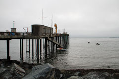 Fog shrouded retro fishing pier Royalty Free Stock Image