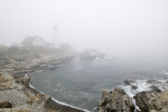 Fog shrouds the Portland Head Lighthouse in Cape Elizabeth, Maine Stock Photos