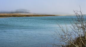 Fog sits over the inlet rivers stock photography