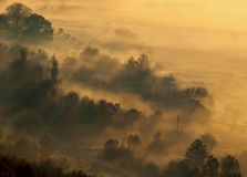 Fog at small village. Fog in early morning at small village. Horizontal color photo Royalty Free Stock Photo