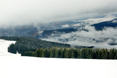 Fog and snow in Carpathians.  Royalty Free Stock Photography