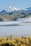 Fog and Snowy Peaks Stock Photo