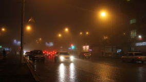 Fog in street of night city and cars on the road. stock video footage
