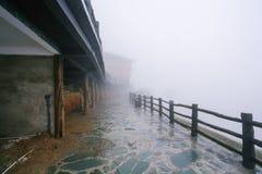 Fog on street of Tiantouzhai village. Travel to China - fog on street of Tiantouzhai village in area of Dazhai Longsheng Rice Terraces (Dragon's Backbone terrace Royalty Free Stock Photography