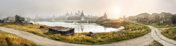 Fog suddenly came. Sudden fog over the Solovetsky monastery on a summer morning Royalty Free Stock Images